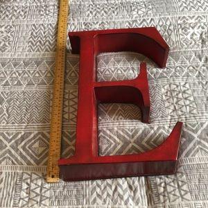 Metal E sign